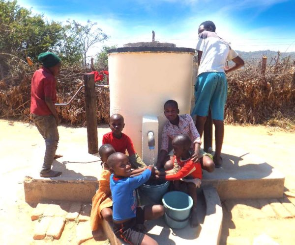 Children and teenagers using Elephant Pump (002)